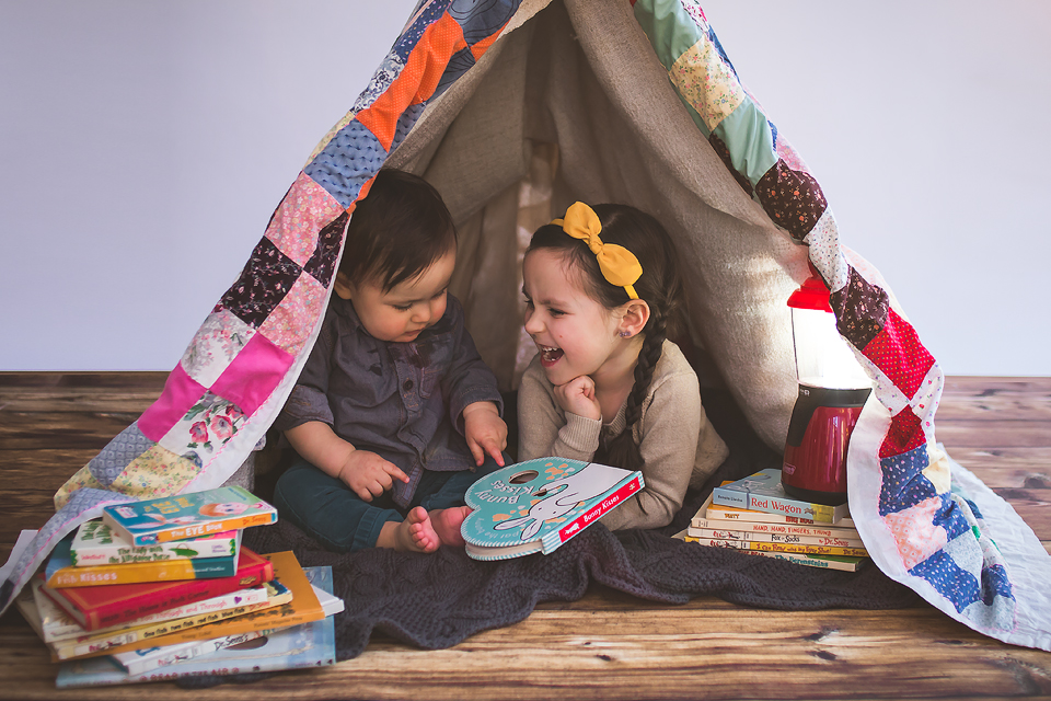 Siblings reading in a quilt tent | Bethesda, MD Newborn Baby and Family Photographer Tonya Teran Photography