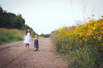 Siblings in a yellow flower field - Tonya Teran Photography - Rockville, MD Newborn Baby and Family Photographer